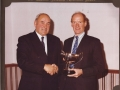 Danny presenting the Trust Trophy to Don Ritchie