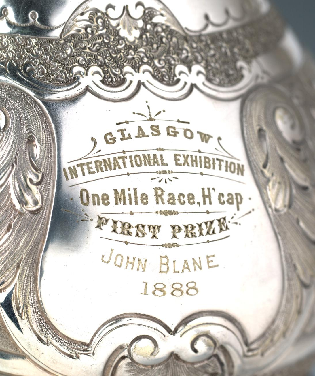 The inscription on the EE Mile Trophy