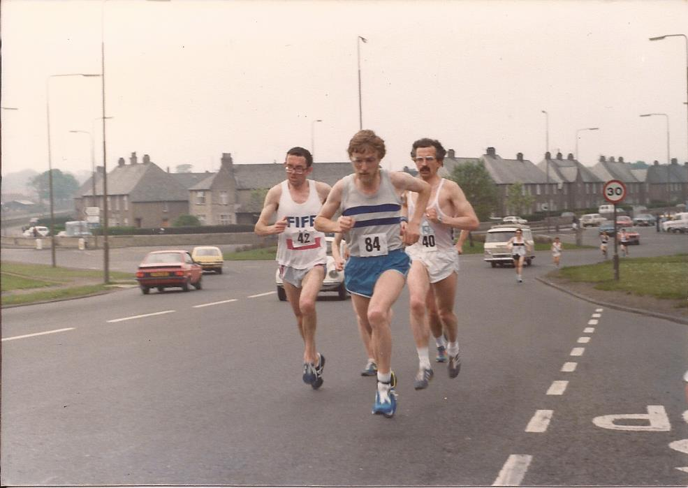Youngson leading Macgregor and Macfarlane; Gerry Gaffney in the background