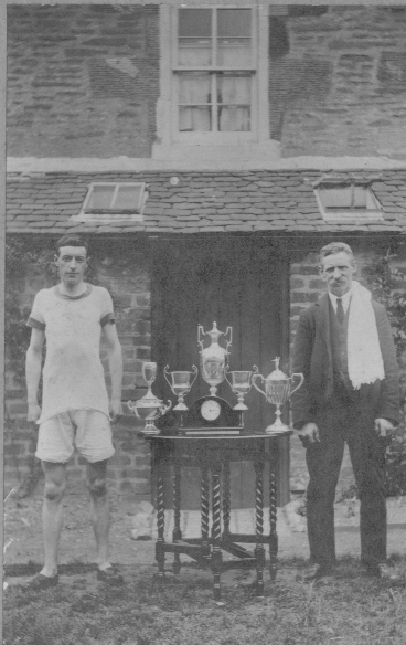 6 James McIntyre with trophies & trainer